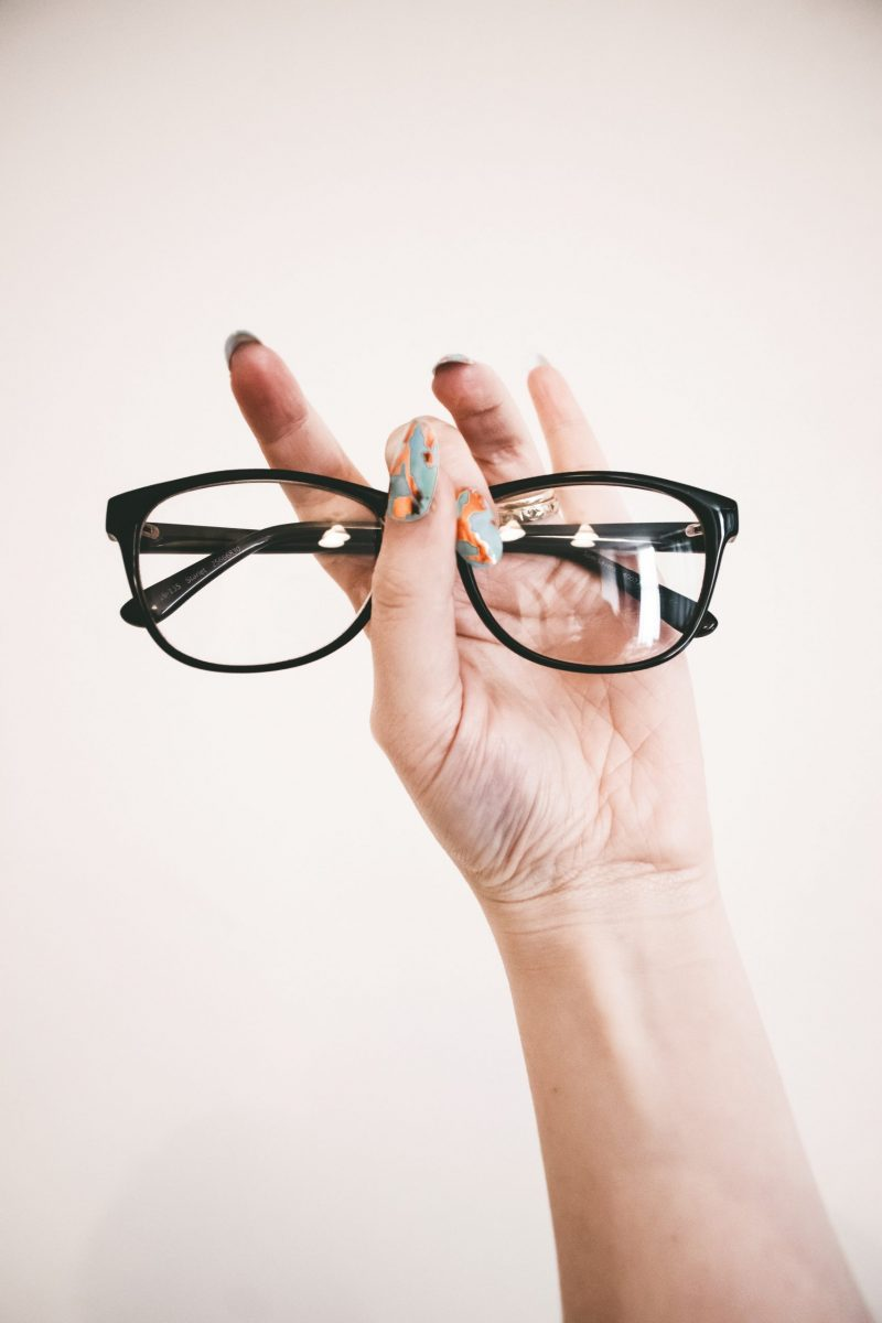 photo-of-person-holding-eyeglasses